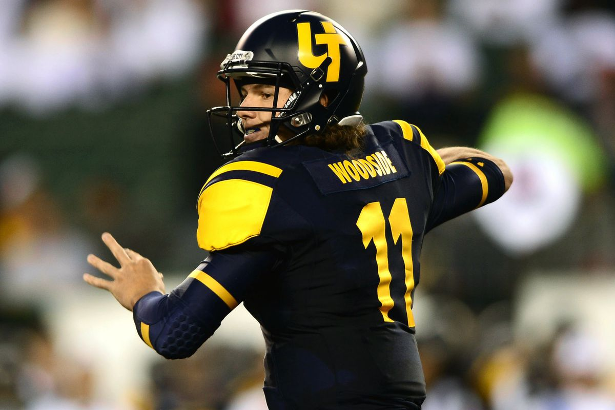 Logan Woodside threw for 339 yards and accounted for three touchdowns.