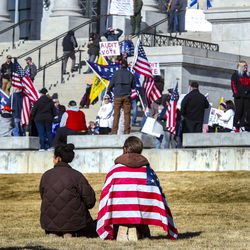 Supporters of President Donald Trump rally on the steps of the Capitol in Salt Lake City on Wednesday, Jan. 6, 2021.