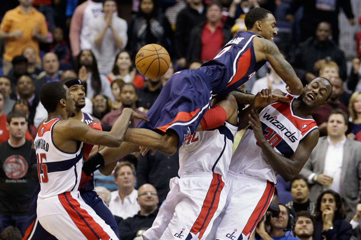 Jeff Teague takes out Earl Barron, Jordan Crawford, and Nene Hilario with a suicide dive from the apron.