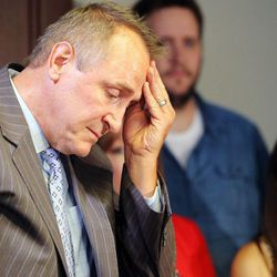 Following his statement, former Utah Attorney General Mark Shurtleff rubs his head at the law offices of Snow, Christensen & Martineau in Salt Lake City Tuesday, July 15, 2014.