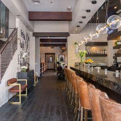 The main bar and staircase at Hamtons