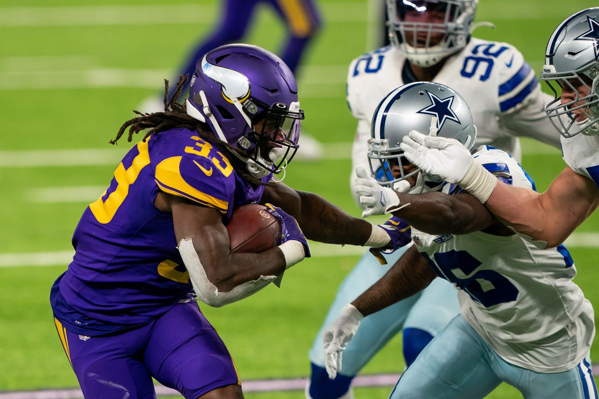 Minnesota Vikings running back Dalvin Cook (33) runs with the ball in the third quarter against the Dallas Cowboys at U.S. Bank Stadium.