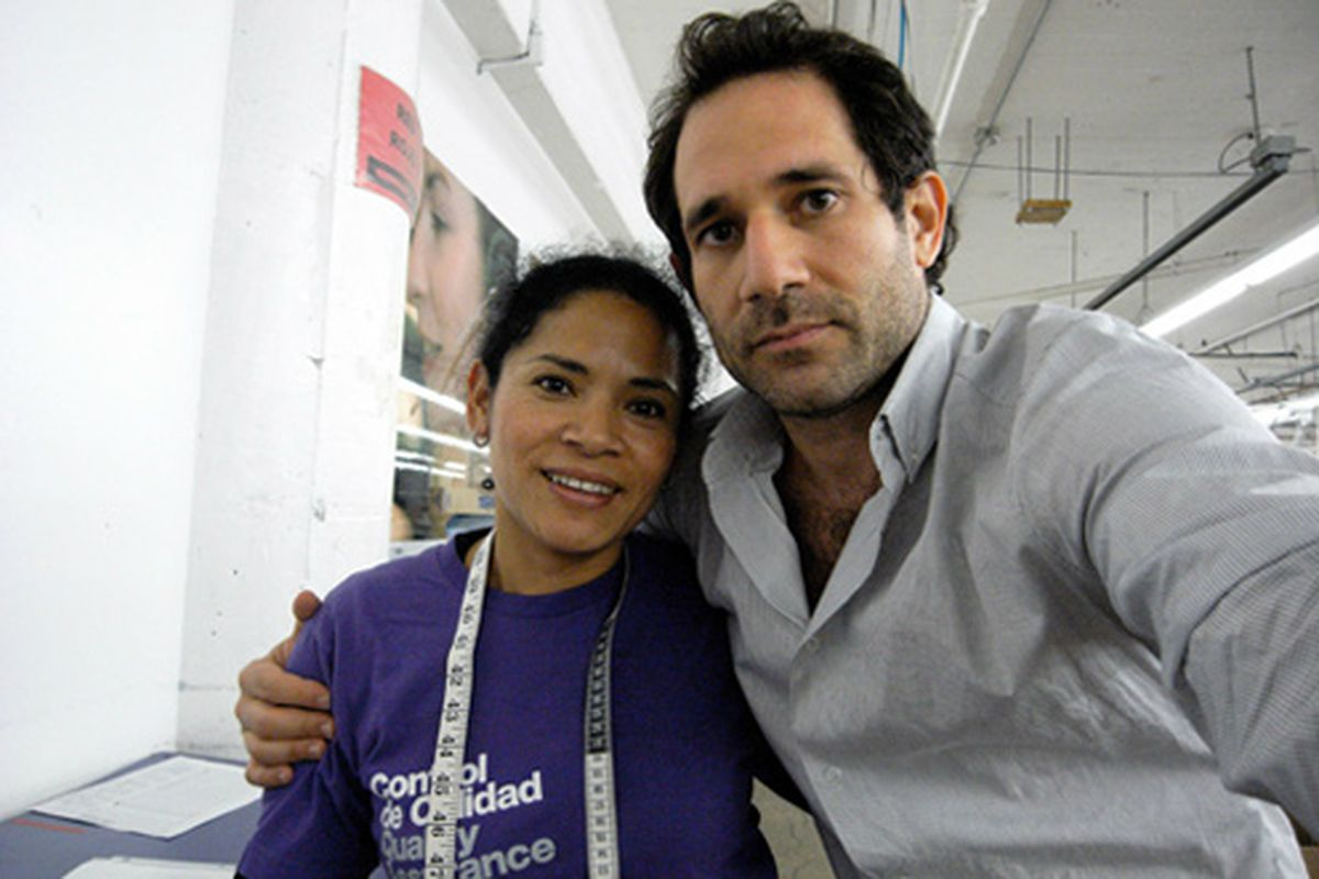 """Ousted CEO Dov Charney with a Quality Assurance employee at his former company's DTLA factory. Image via <a href=""""http://www.americanapparel.net/flash/src/auto/198/"""">American Apparel</a>"""