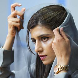 Pakistani Foreign Minister Hina Rabbani Khar, adjusts her veil during an interview with the Associated Press in Washington, Thursday, Sept. 20, 2012.