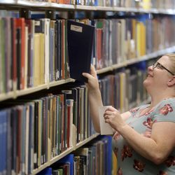 Sara Peterson is looking for a book at the Family History Library at The Church of Jesus Christ of Latter-day Saints in Salt Lake City on Tuesday, July 6, 2021. The library reopened after 16 months of closure.
