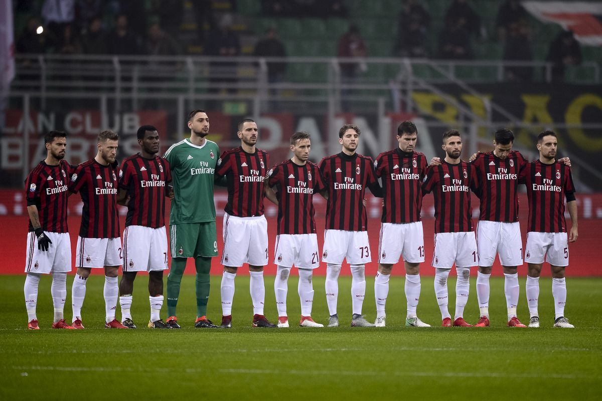 Players of AC Milan observe a minute of silence for the...