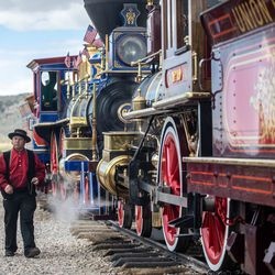 A train operator walks along the length of the locomotives during a celebration marking the 152nd anniversary of the completion of the nation's first transcontinental railroad at Golden Spike National Historic Park in Corrine on Monday, May 10, 2021. Visitors gathered at the park to mark the anniversary and to watch a reenactment of the 1869 ceremony.