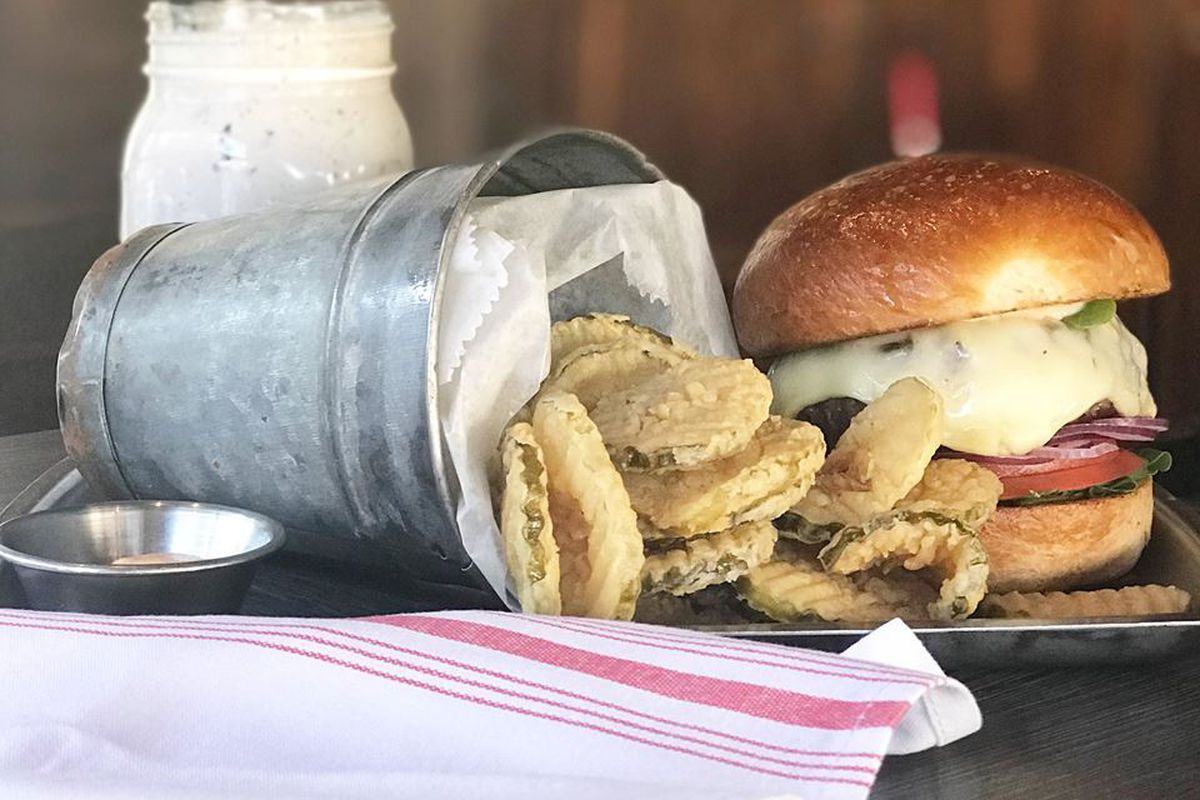 A burger with fried pickles and a milkshake at A&B Burgers in Beverly