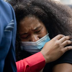 Megan Belcher, Jacob Blake's sister, cries during a press conference Tuesday afternoon, Aug. 25, 2020. Police shot Blake at least seven times in the back Sunday as he was breaking up a fight in Kenosha, according to his attorneys.
