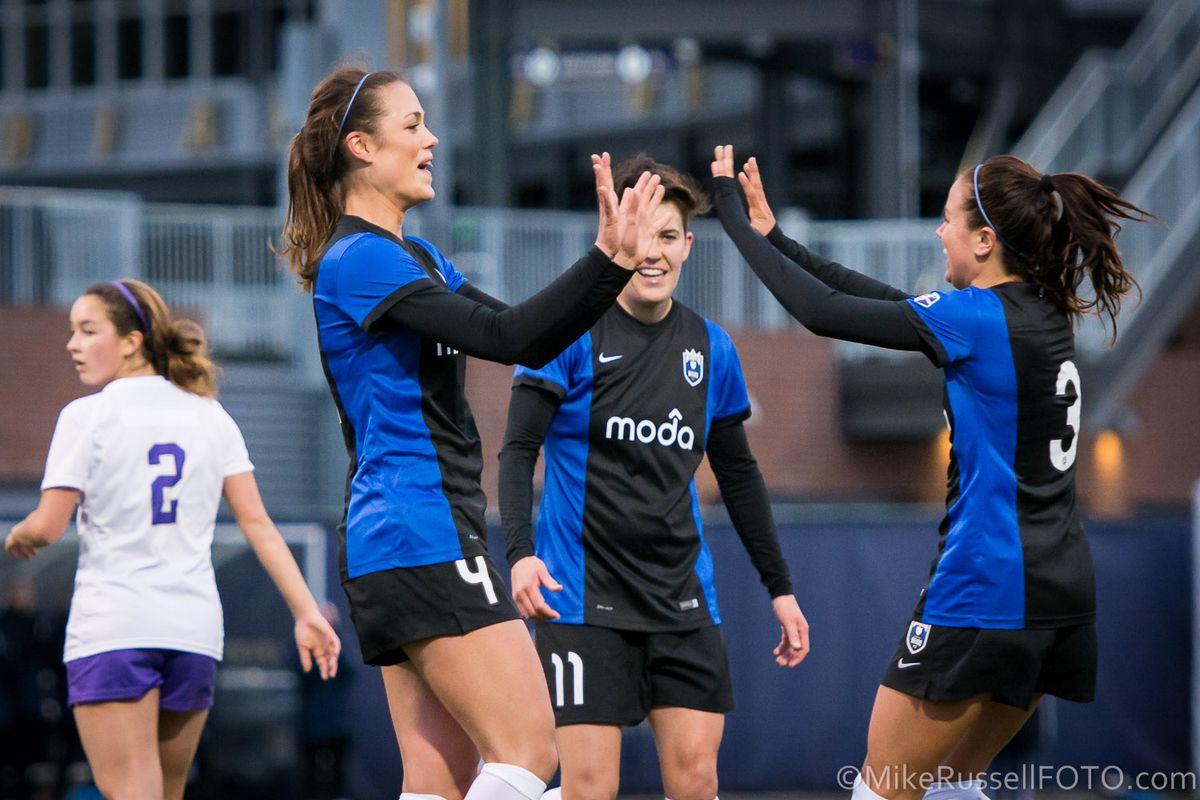 Kate Deines celebrates a goal with Keelin Winters and Lauren Barnes