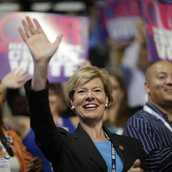 Rep. Tammy Baldwin, D-Wis., waves as she sit with state delegates during the Democratic National Convention in Charlotte, N.C., on Wednesday, Sept. 5, 2012.
