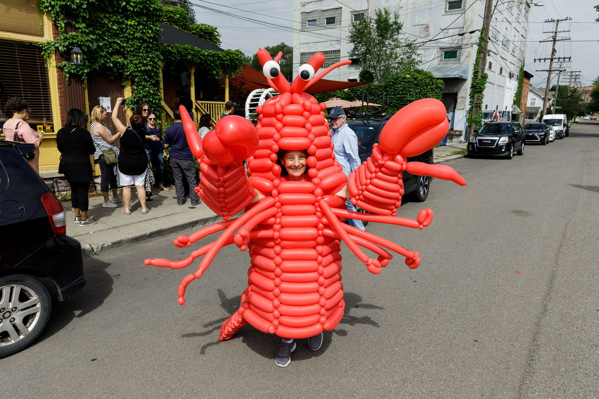 A man dressed in a lobster costume on the street