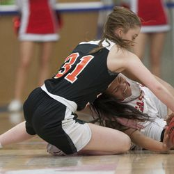East's Margarita Satini and Timpview's Taylor Ross grab for the ball during East's 68-48 victory against Timpview in the Class 5A state championship game at Salt Lake Community College in Taylorsville on Saturday, Feb. 24, 2018.