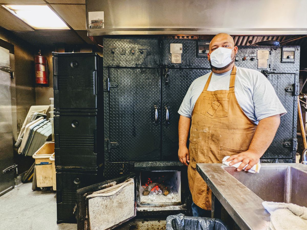 Maple Block Barbecue pitmaster Rudy Suazo in front of the smokers inside the Culver City restaurant's kitchen.