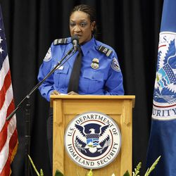 TSA supervisory officer Sheleta Fraser speaks during the public memorial service for slain TSA officer Gerardo Hernandez, Tuesday, Nov. 12, 2013. Hernandez was the first TSA officer killed in the line of duty when a gunman pulled a rifle from a bag and shot the 39-year-old father of two on Nov. 1, at Los Angeles International Airport. Two TSA officers and a teacher were injured before airport police wounded the gunman, Paul Ciancia.