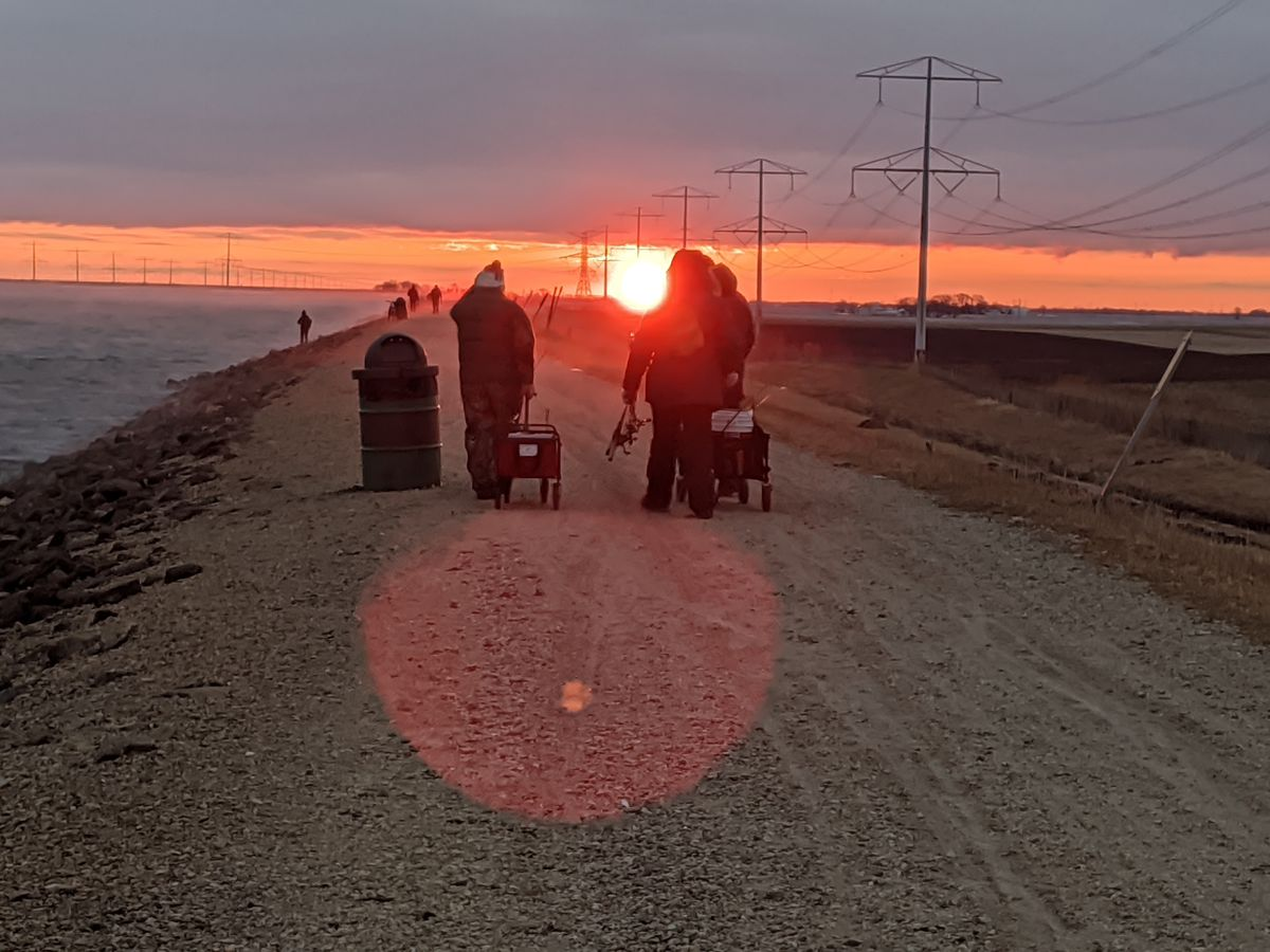 Three anglers were among those trekking out at dawn to fish opening day last year at LaSalle Lake, which reopens Monday. Credit: Dale Bowman