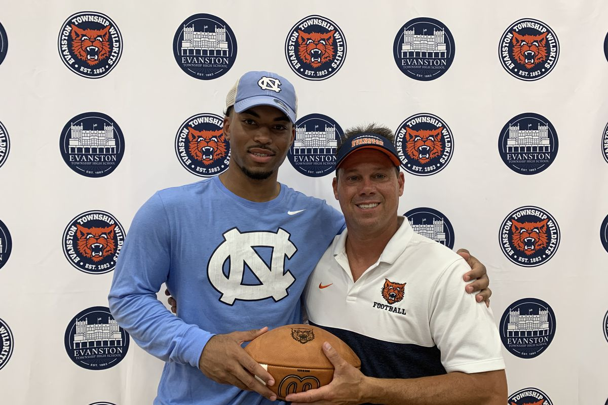 Evanston linebacker Sebastian Cheeks, with coach Mike Burzawa, announced his commitment to North Carolina on Wednesday. Cheeks is a four-star prospect ranked fourth among Illinois seniors.