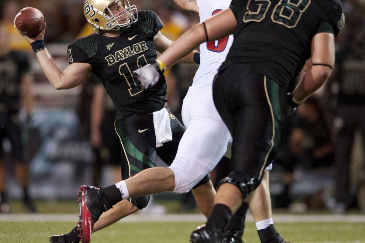 WACO, TX - SEPTEMBER 2: Nick Florence #11 of the Baylor University Bears throws a pass against the SMU Mustangs on September 2, 2012 at Floyd Casey Stadium in Waco, Texas.  (Photo by Cooper Neill/Getty Images)