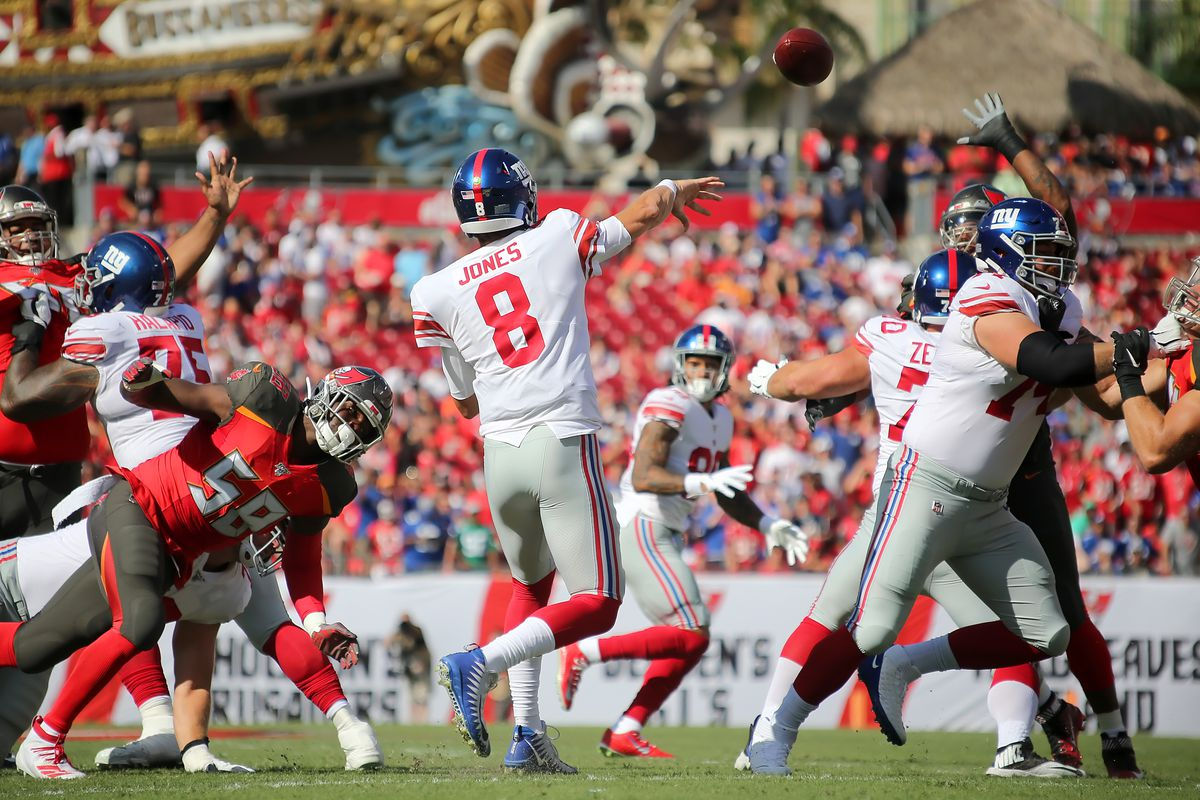 Daniel Jones of the Giants throws a pass on his first regular season play during the regular season game between the New York Giants and the Tampa Bay Buccaneers on September 22, 2019 at Raymond James Stadium in Tampa, Florida.