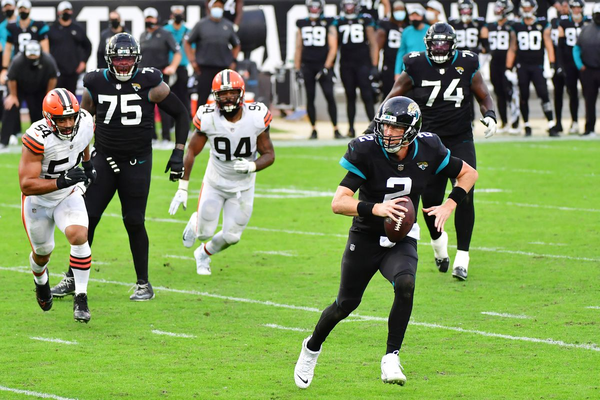 Mike Glennon #2 of the Jacksonville Jaguars scrambles in the fourth quarter against the Cleveland Browns at TIAA Bank Field on November 29, 2020 in Jacksonville, Florida.