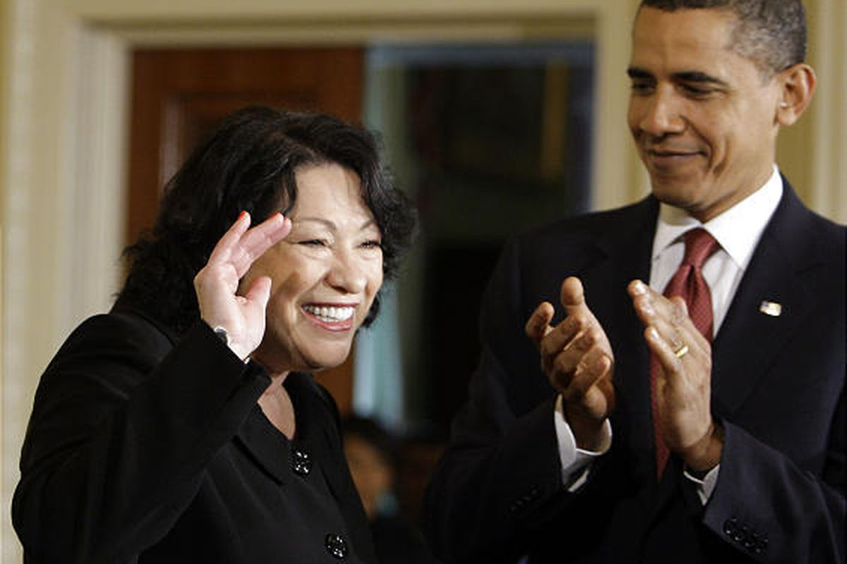 President Barack Obama applauds new Supreme Court Justice Sonia Sotomayor at the start of a reception in the East Room of The White House in Washington Wednesday.