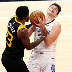 Utah Jazz forward Royce O'Neale (23) ties up Memphis Grizzlies guard Grayson Allen (3) as the Utah Jazz and the Memphis Grizzlies play in Game 5 of an NBA basketball first-round playoff series at Vivint Arena in Salt Lake City on Wednesday, June 2, 2021.