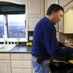In this Dec. 13, 2012, photo, Idaho State Speaker of the House Scott Bedke prepares breakfast at his home in Oakley, Idaho. Bedke's family heritage is established as being some of the founding settlers in the Oakley area, a legacy that three generations later is not lost on Scott. Along with his brother Eric, Scott runs one of the largest operations of cow-calf pairs on 130,000 acres of federal grazing allotments in Idaho and Nevada, and he recently defeated three-term speaker Lawerence Denney in the 57-member Republican caucus. (AP Photo/The Idaho Statesman, Darin Oswald)  MANDATORY CREDIT; LOCAL TV OUT (KTVB 7)