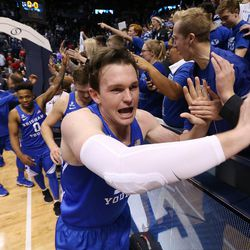 Brigham Young Cougars forward Payton Dastrup (15) celebrates the win over Utah in Provo on Saturday, Dec. 16, 2017. BYU won 77-65.