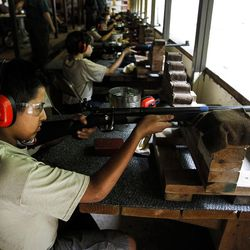 Diego Delgado, 12, who is apart of the Boy Scouts of America, shoots a gun at the firing the range during activity time at Camp Tracy in Mill Creek Canyon on Friday, July 22, 2016.