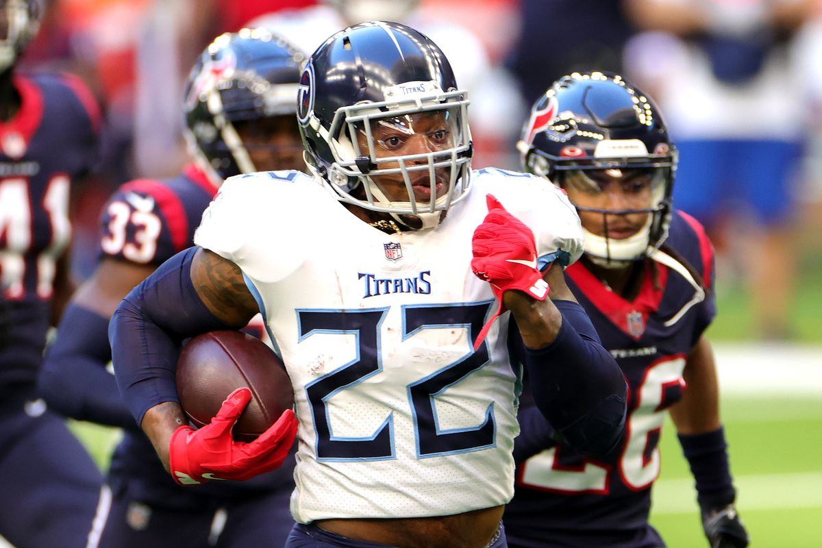 Derrick Henry #22 of the Tennessee Titans in action against the Houston Texans during a game at NRG Stadium on January 03, 2021 in Houston, Texas.