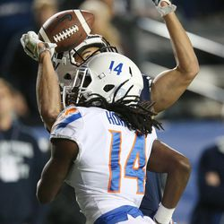 Brigham Young Cougars wide receiver Neil Pau'u (84) can't come up with the balk on the defense from Boise State Broncos cornerback Tyler Horton (14) in Provo on Friday, Oct. 6, 2017.