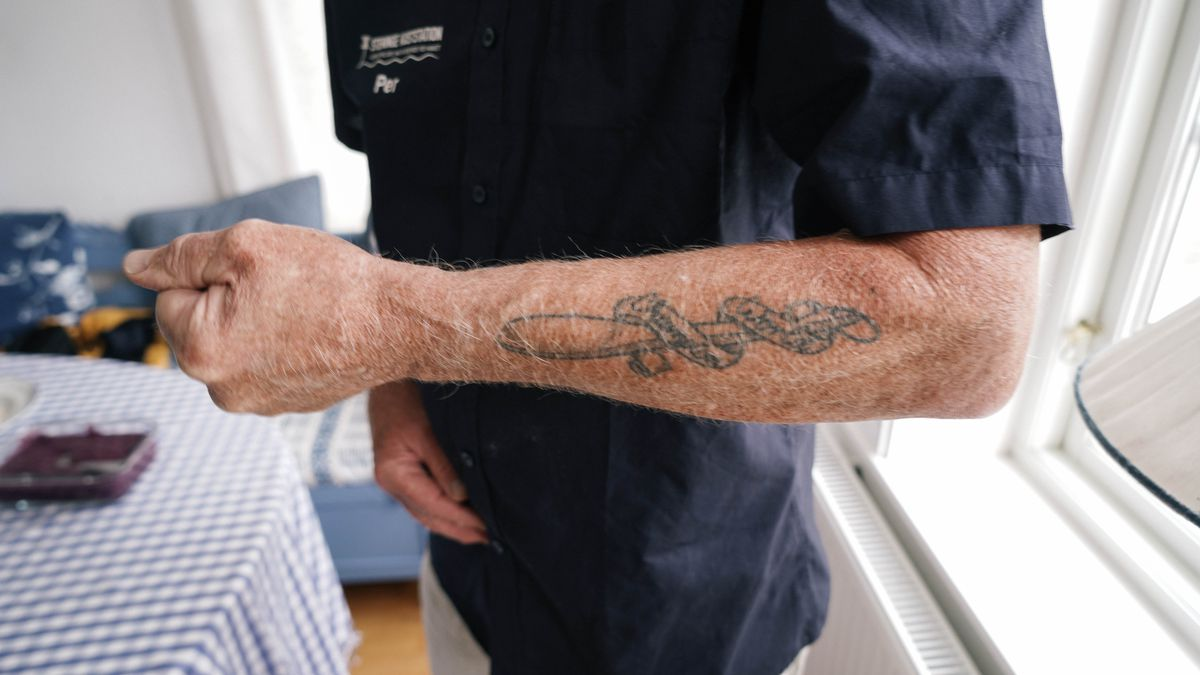 A forearm with a tattoo.