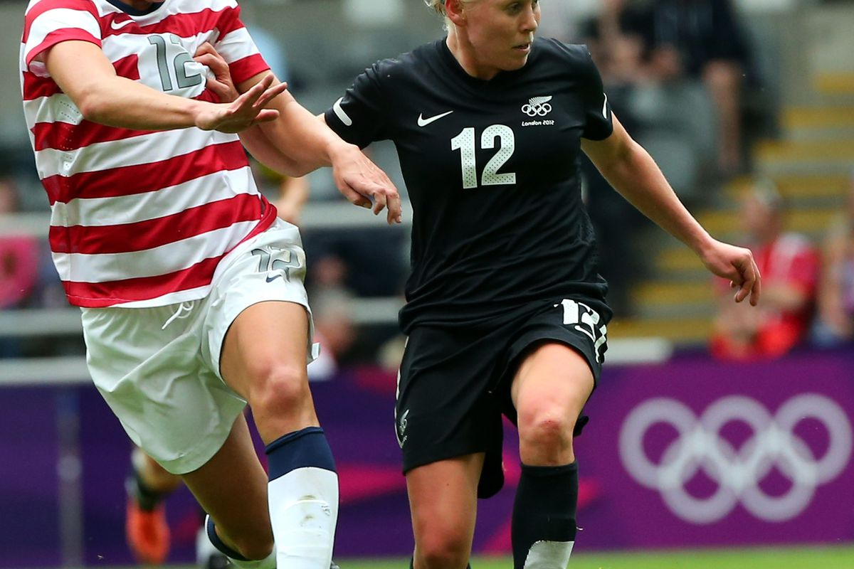 Betsy Hassett (right) played in the London 2012 Olympic games for her native New Zealand. That experience should help the senior midfielder in leading the Golden Bears this season.