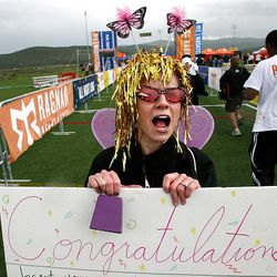 """Volunteer Shellie Herrscher, or """"The Finish Line Fairy,"""" directs racers to the finish line of the Ragnar Relay Wasatch Back race in Park City on Saturday."""