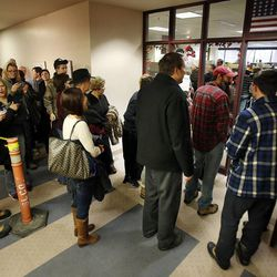 Couples wait to get marriage licenses outside the Salt Lake County clerk's office, Monday, Dec. 23, 2013. U.S. District Judge Robert Shelby denied a motion by the state of Utah to halt same-sex marriages pending an appeal.