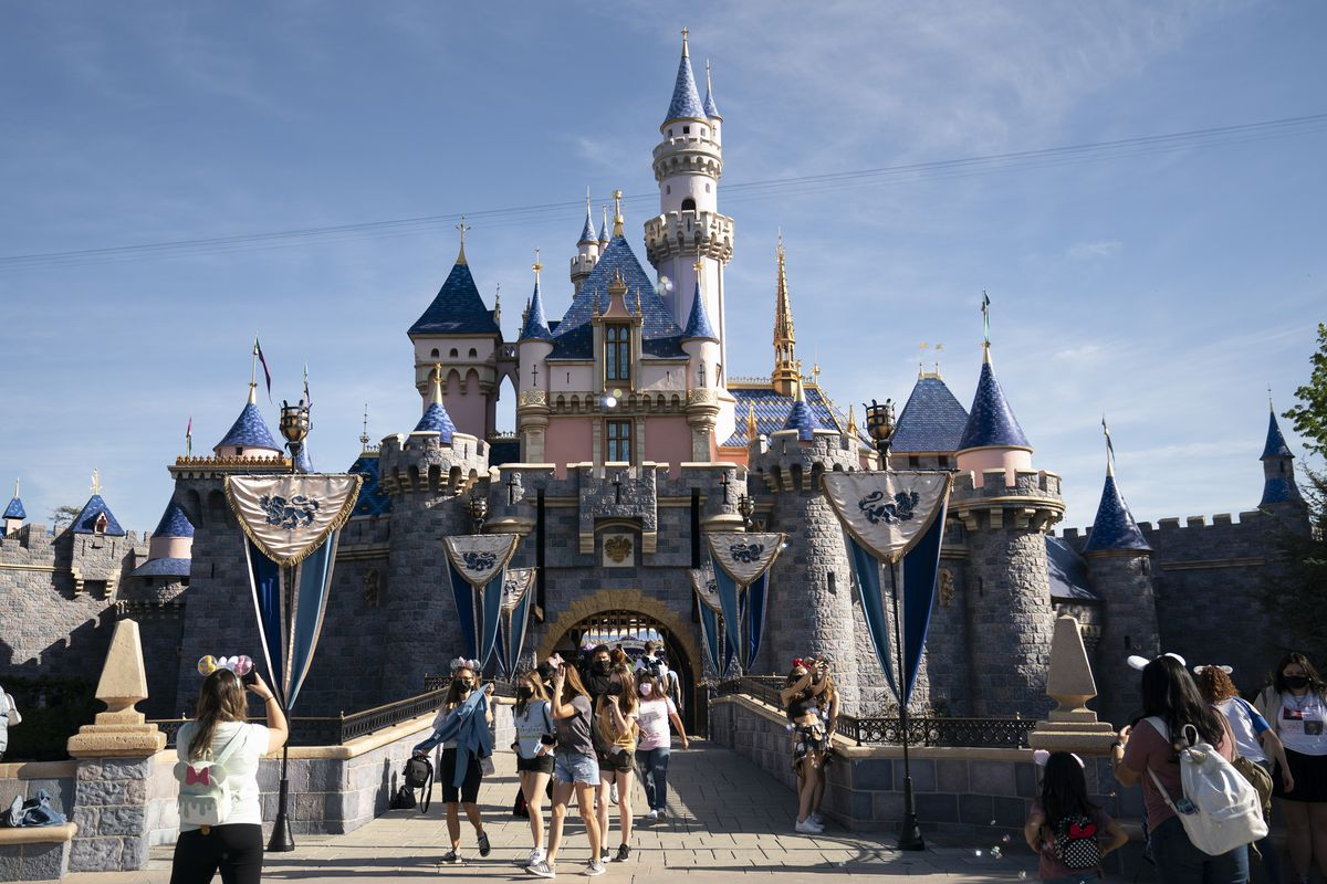Visitors exit The Sleeping Beauty Castle at Disneyland in Anaheim, California.