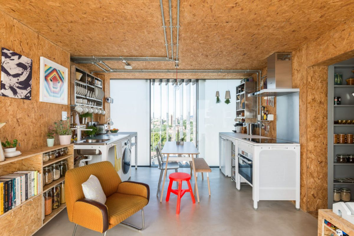 The duplex penthouse occupies the former water tank of londons keeling house photos via the modern house