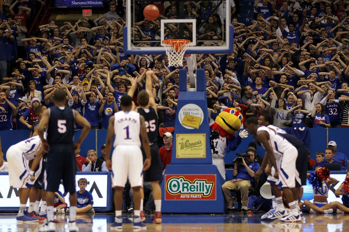 LAWRENCE, KS - NOVEMBER 30:  Kansas Jayhawk fans distract Pablo Bertone #25 of the Florida Atlantic Owls during a free throw in the game on November 30, 2011 at Allen Fieldhouse in Lawrence, Kansas.  (Photo by Jamie Squire/Getty Images)