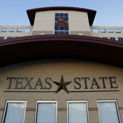 """In this photo taken Aug. 23, 2012, an entrance to Texas State's Bobcat Stadium is seen on the campus of Texas State in San Marcos, Texas. Five programs """""""" Georgia State, Texas-San Antonio, South Alabama, Massachusetts and Texas State """""""" are at various stages in the two-year transition process to the top-tier Football Bowl Subdivision this season."""