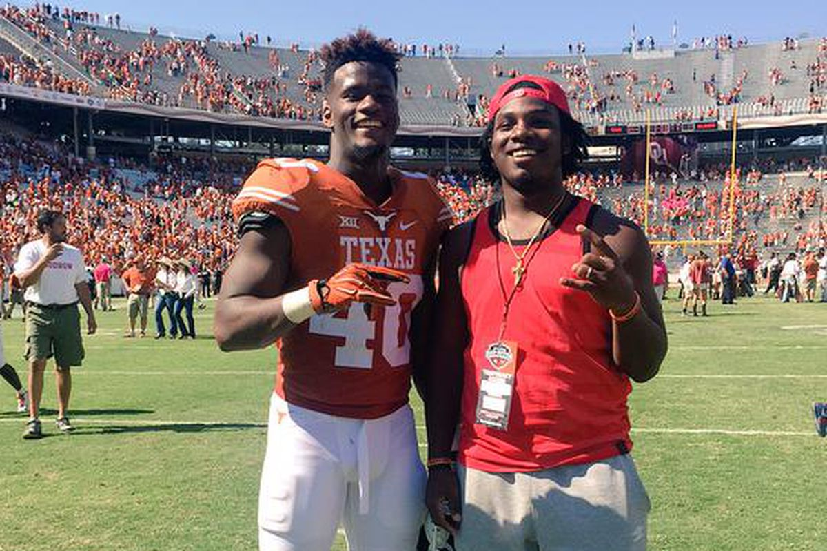 2016 Longhorn commit DeMarco Boyd (right) posing with Naashon Hughes after the win over Oklahoma on October 10, 2015