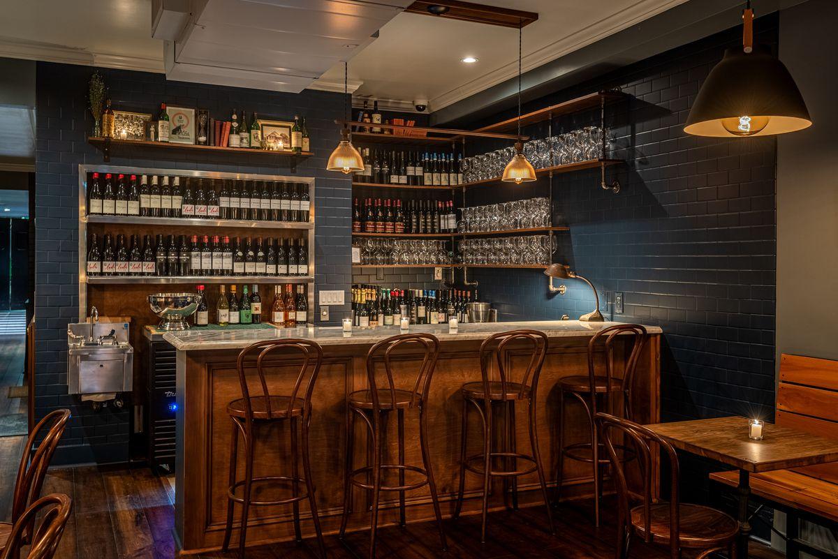 A marble corner bar at a new dim wine bar restaurant.