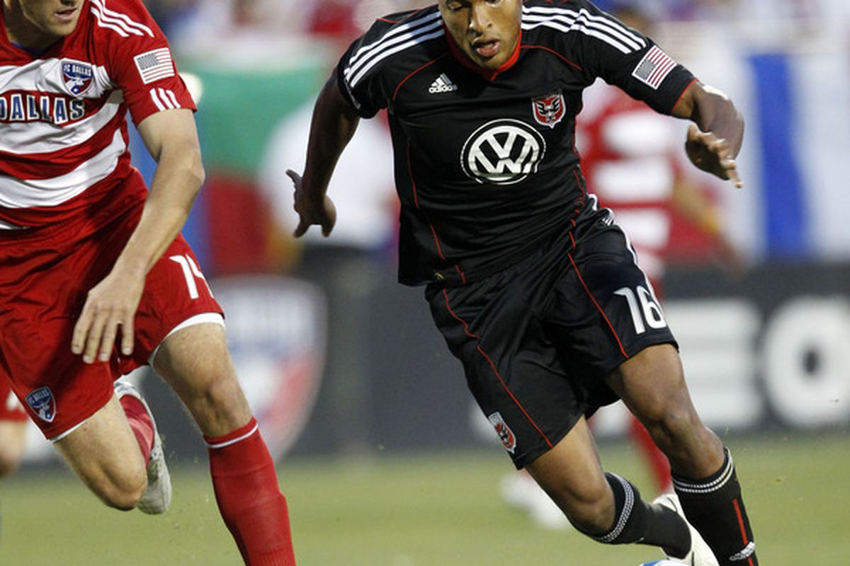 FRISCO, TX - MAY 8: Jordan Graye #16 of D.C. United dribbles the ball against dribbles past George John #14 of FC Dallas at Pizza Hut Park on May 8, 2010 in Frisco, Texas. (Photo by Layne Murdoch/Getty Images)