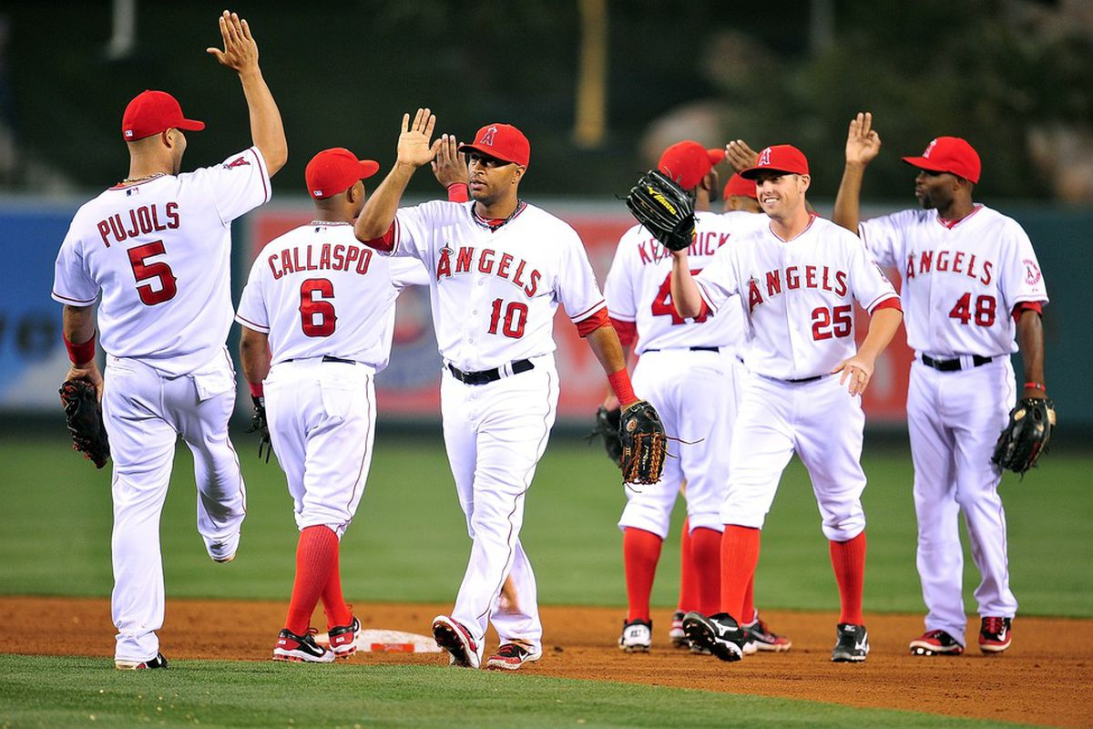 April 20, 2012; Anaheim, CA, USA; Los Angeles Angels left fielder Vernon Wells (10) and the Angels celebrate their 6-3 victory against the Baltimore Orioles at Angel Stadium. Mandatory Credit: Gary A. Vasquez-US PRESSWIRE