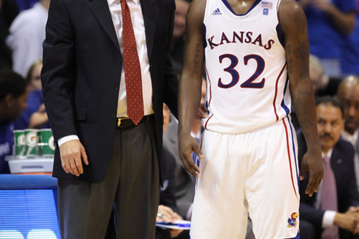 LAWRENCE KS - DECEMBER 18:  Head coach Bill Self  of the Kansas Jayhawks talks with Josh Selby #32 during the game against the USC Trojans on December 18 2010 at Allen Fieldhouse in Lawrence Kansas.  (Photo by Jamie Squire/Getty Images)