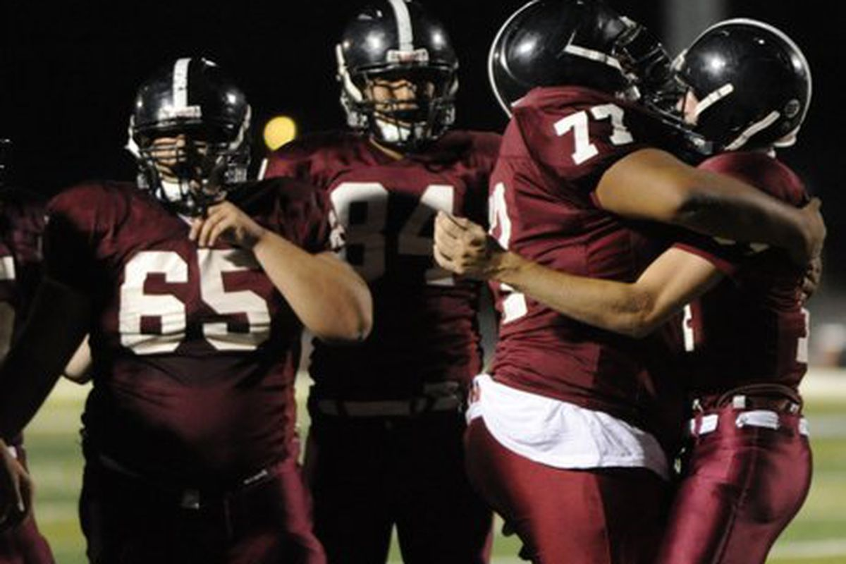 Jamal Brown #77, celebrates with a teammate.