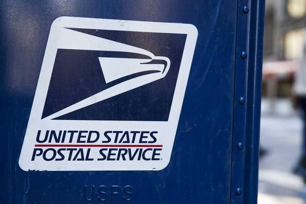 A close-up photo shows a white United States Postal Service logo on a blue blue mailbox.