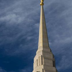 Ogden Utah Temple spire with gold leaf and Moroni statue