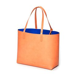 """<b>Large Tote</b> in cammello with royal interior, <a href=""""http://mansurgavriel.com/large-tote-cammello-with-royal/"""">$435</a>"""