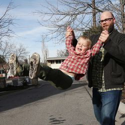 Blair Christensen plays with his son Seth in Salt Lake City Thursday, Jan. 21, 2016.