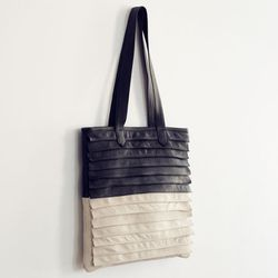 """Up the texture factor while still staying neutral. Great for the office and the weekend. <a href=""""http://ofakind.com/editions/1304-DOMINO-TOTE#.UlxlGOy83hM"""">Collina Strada Domino Tote</a>, $220 at Of a Kind."""